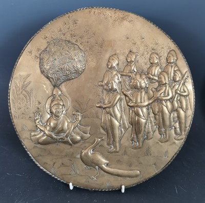 Lot 24 - An antique Indian embossed brass plaque...