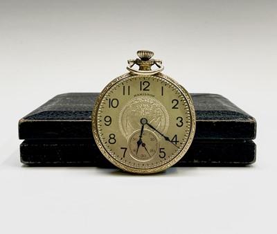 Lot 27 - A gold-plated Hamilton keyless pocket watch...