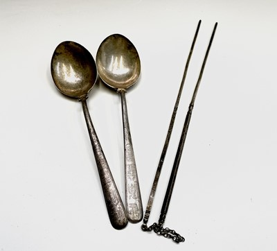 Lot 63 - A pair of Chinese silver presentation spoons...