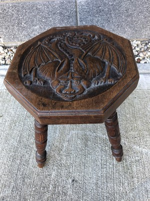 Lot 16 - A 20th century oak carved stool, on four,...