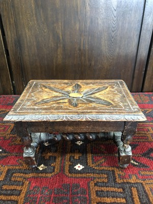 Lot 2 - An early 19th-century oak carved stool, carved...