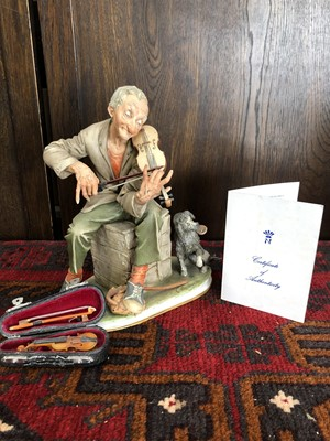 Lot 5 - A bisque Capodimonte figurine of scraping a...