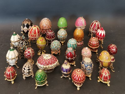 Lot 15 - Approximately thirty enamelled and jewelled...