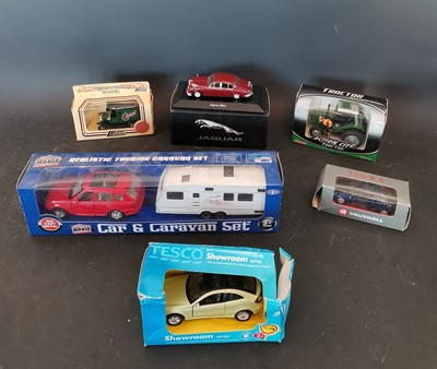 Lot 23 - A collection of die cast toy cars including...