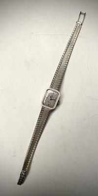 Lot 10 - An Omega ladies 18ct white gold wristwatch...