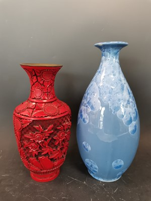 Lot 12 - A Chinese carved cinnabar lacquer vase with a...