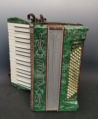 Lot 24 - A vintage German Pietro accordion with case.