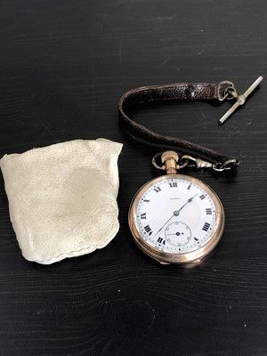 Lot 6 - A gold plated pocket watch, with leather strap,...