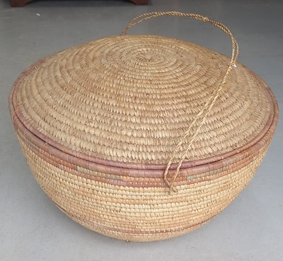 Lot 12 - A handcrafted woven lidded basket, 63cm in...