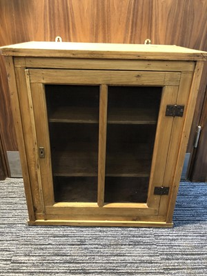 Lot 5 - A 20th-century pine hanging cabinet with a...