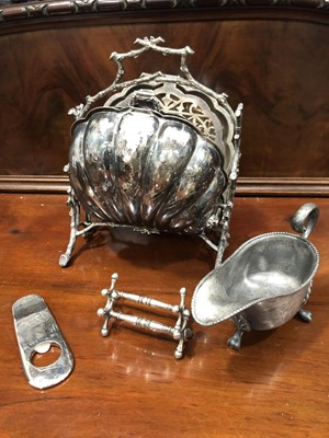 Lot 15 - A silverplate folding biscuit box in shell...
