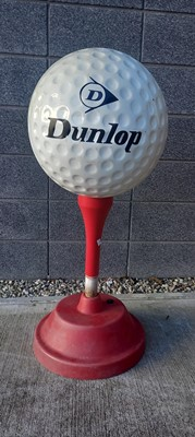 Lot 6 - A Dunlop advertising golf ball and tea with...