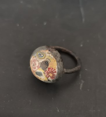 Lot 14 - An antique bronze ring with a mosaic glass...