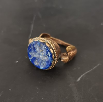 Lot 23 - A late Medieval Middle Eastern bronze ring...