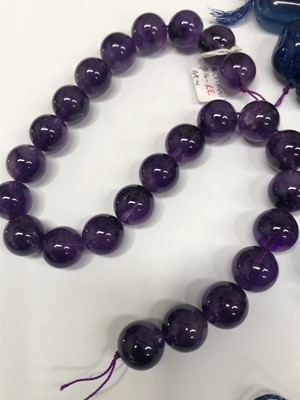 Lot 30 - An amethyst bead necklace, a sodalite bead...