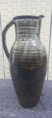 Lot 5 - A tall studio pottery jug with scraffito wave...