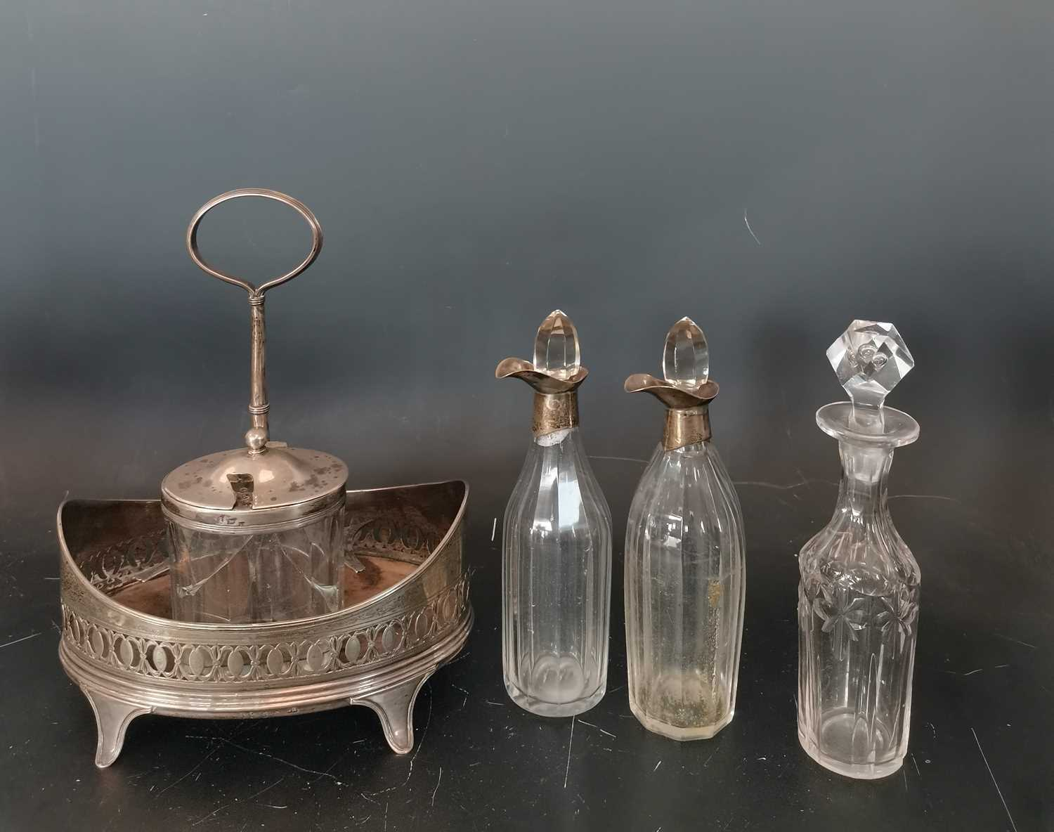 Lot 7 - A George III silver cruet stand with various...