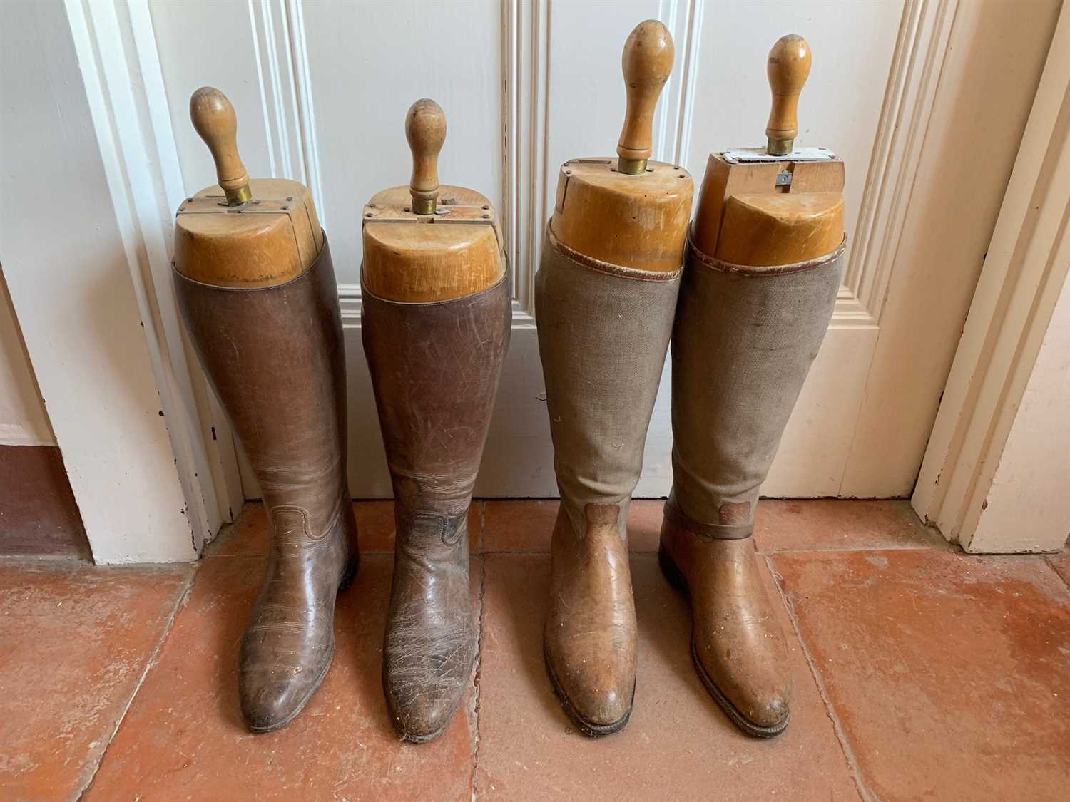 Lot 1-Two pairs of leather riding boots, with wooden...