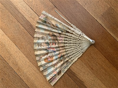 Lot 26-An 18th century fan with hand painted decoration...
