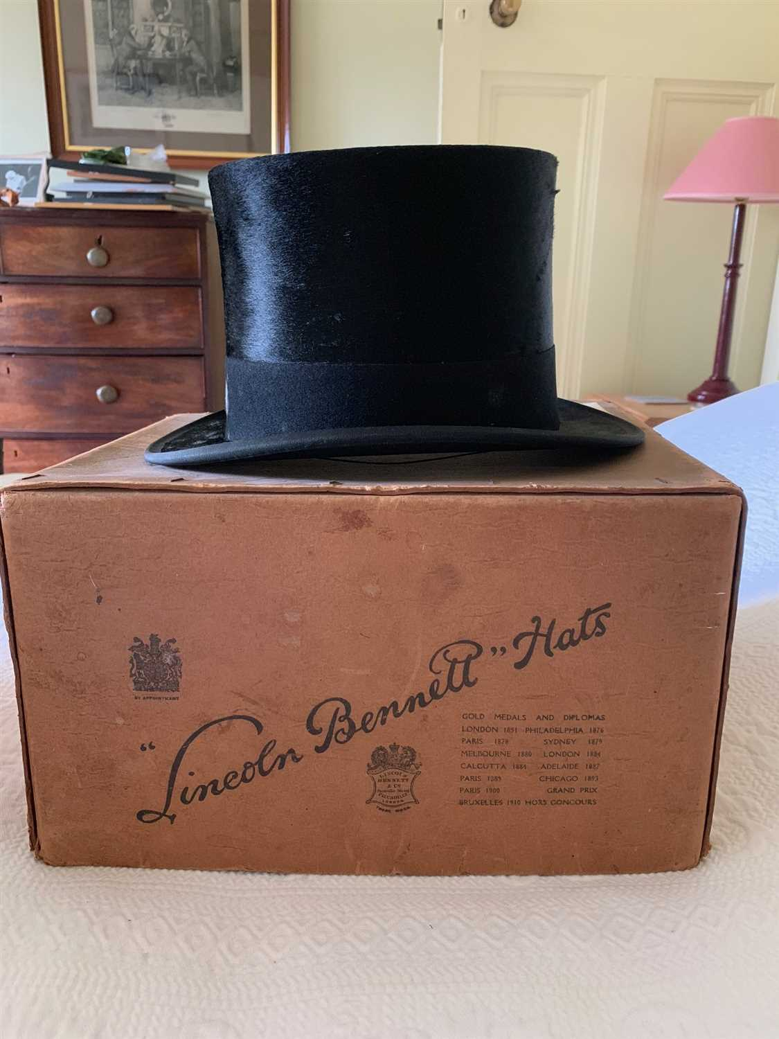 Lot 22-A silk top hat bearing label Harman & Son Hatters,...