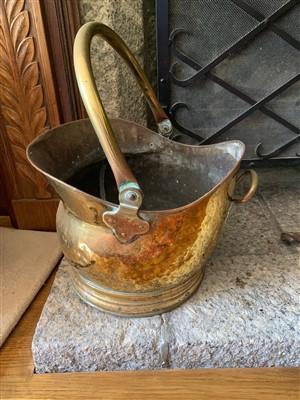 Lot 34-A brass coal helmet.
