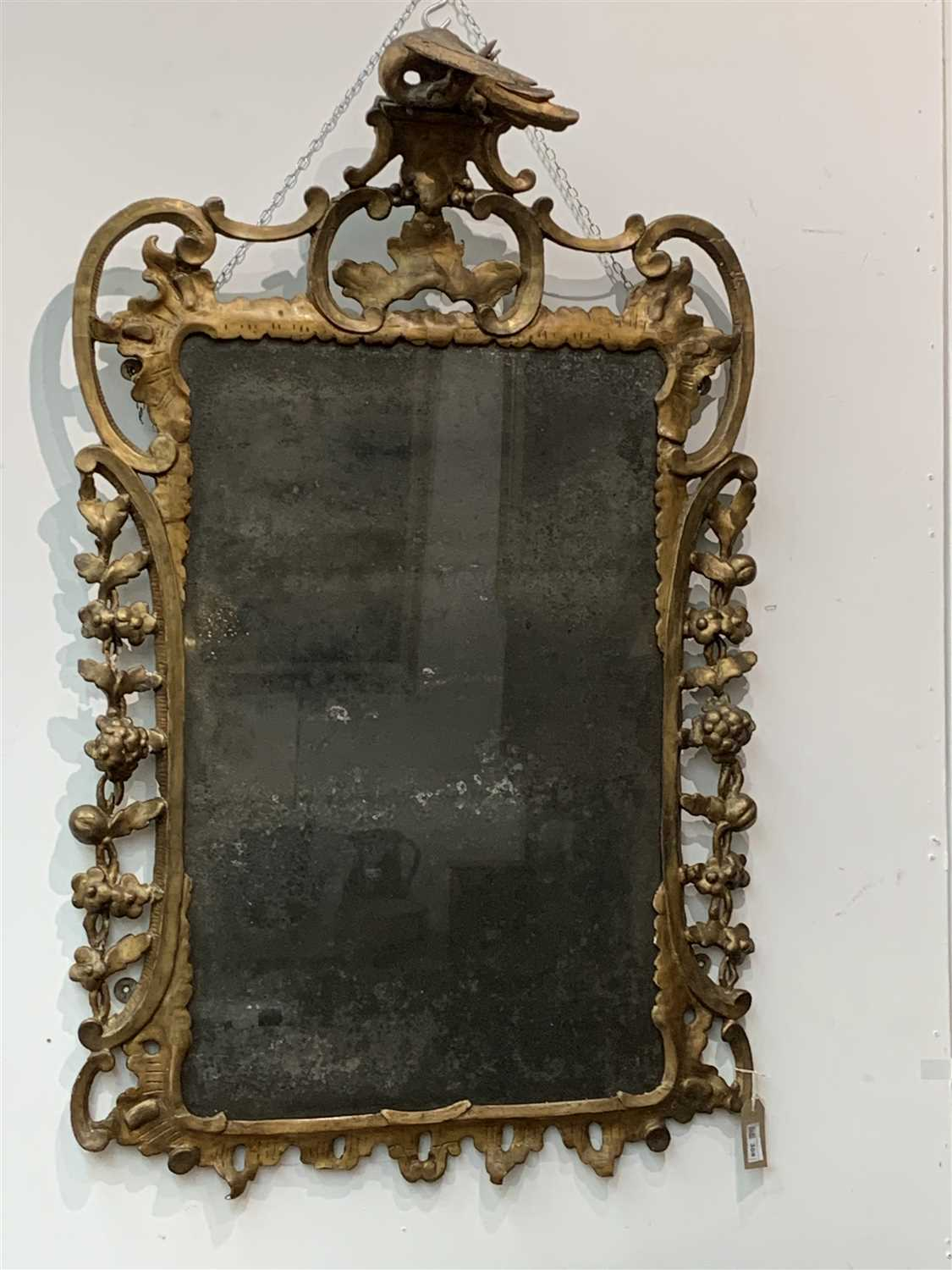 Lot 308-A giltwood pier glass, early 18th century.